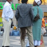 Man with very long dreads that go under his coat