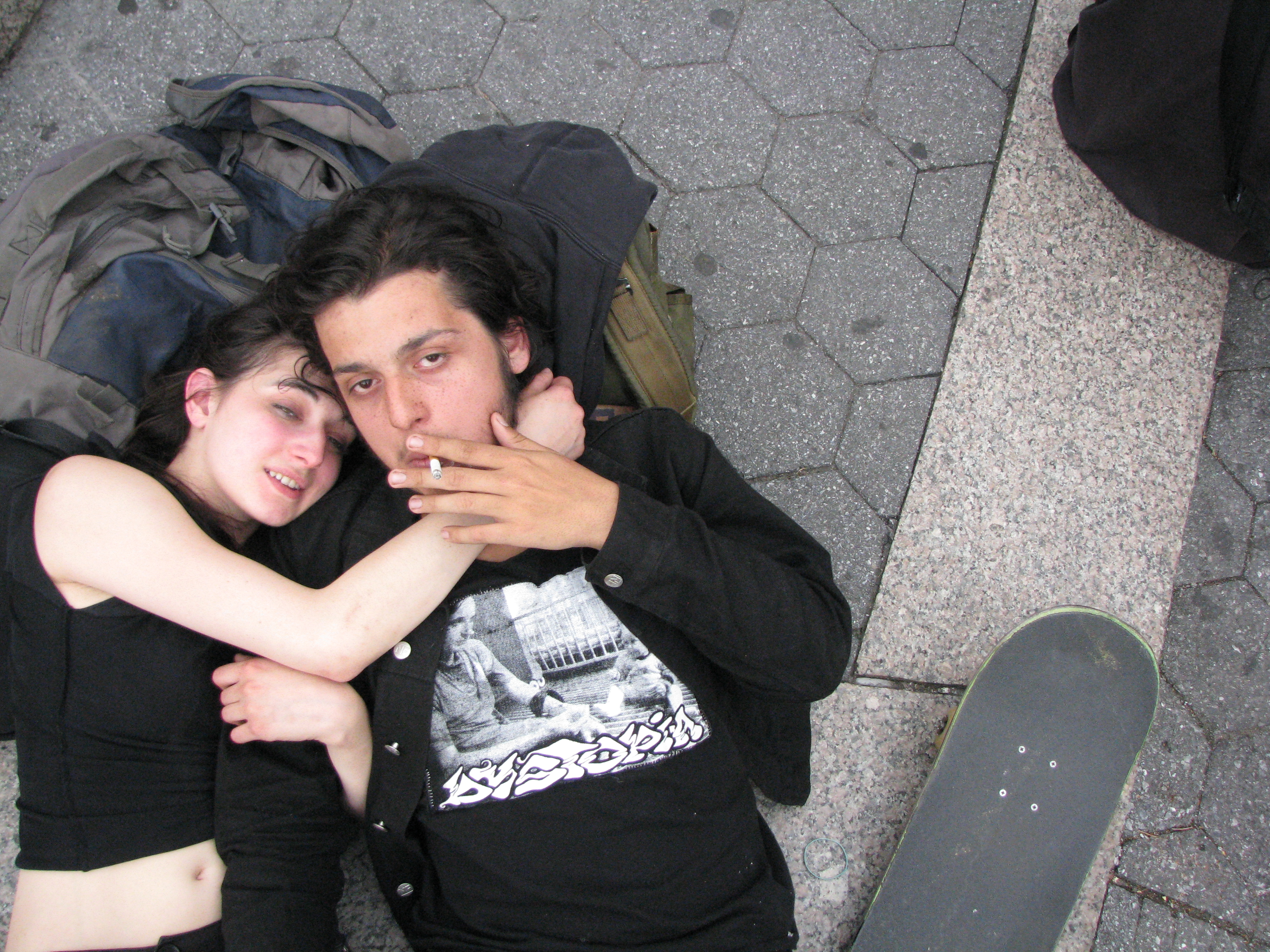 young couple lying down on steps