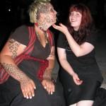 redhead scratching tattooed cat woman under chic