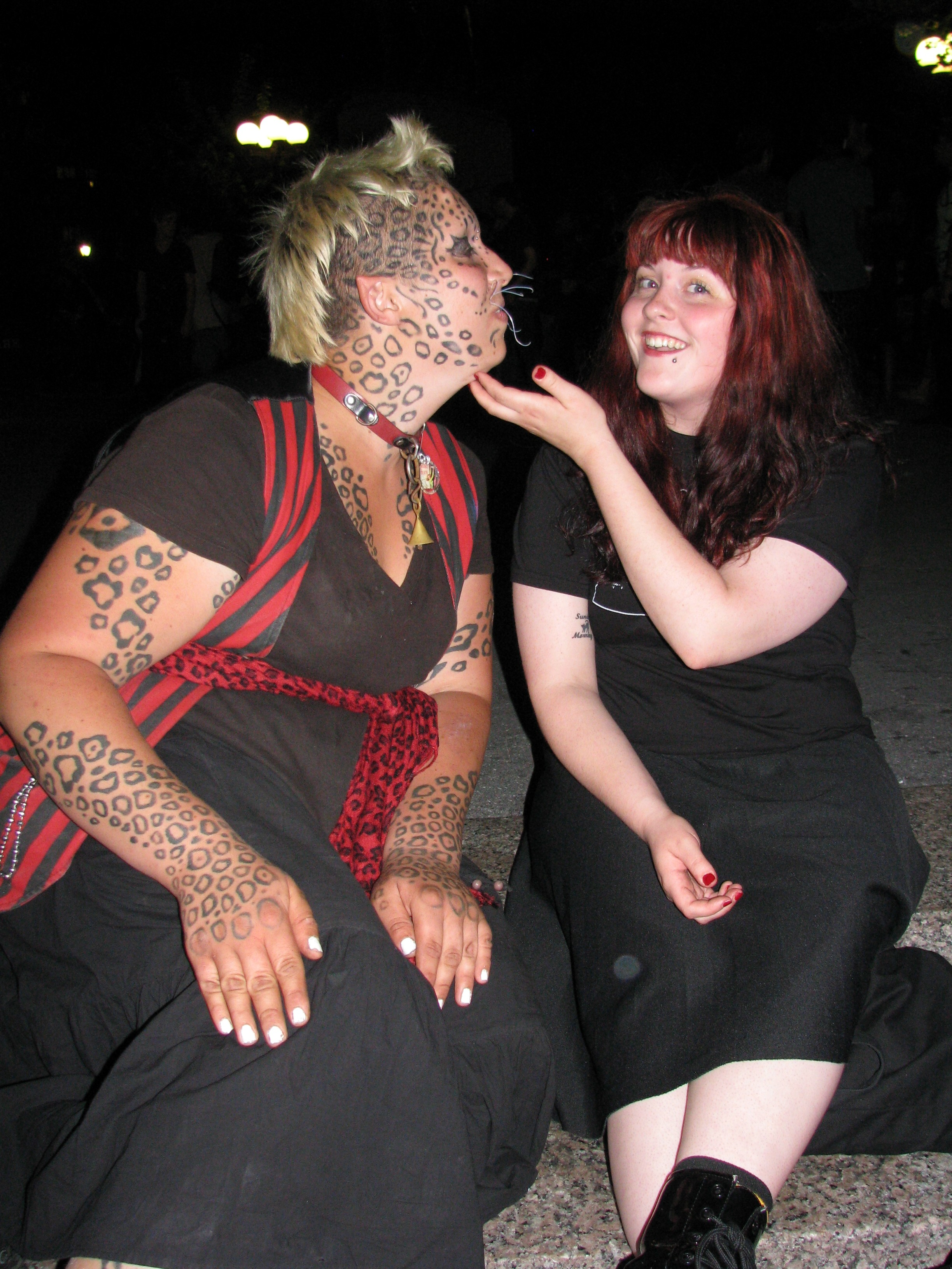 redhead scratching tattooed cat woman under chic