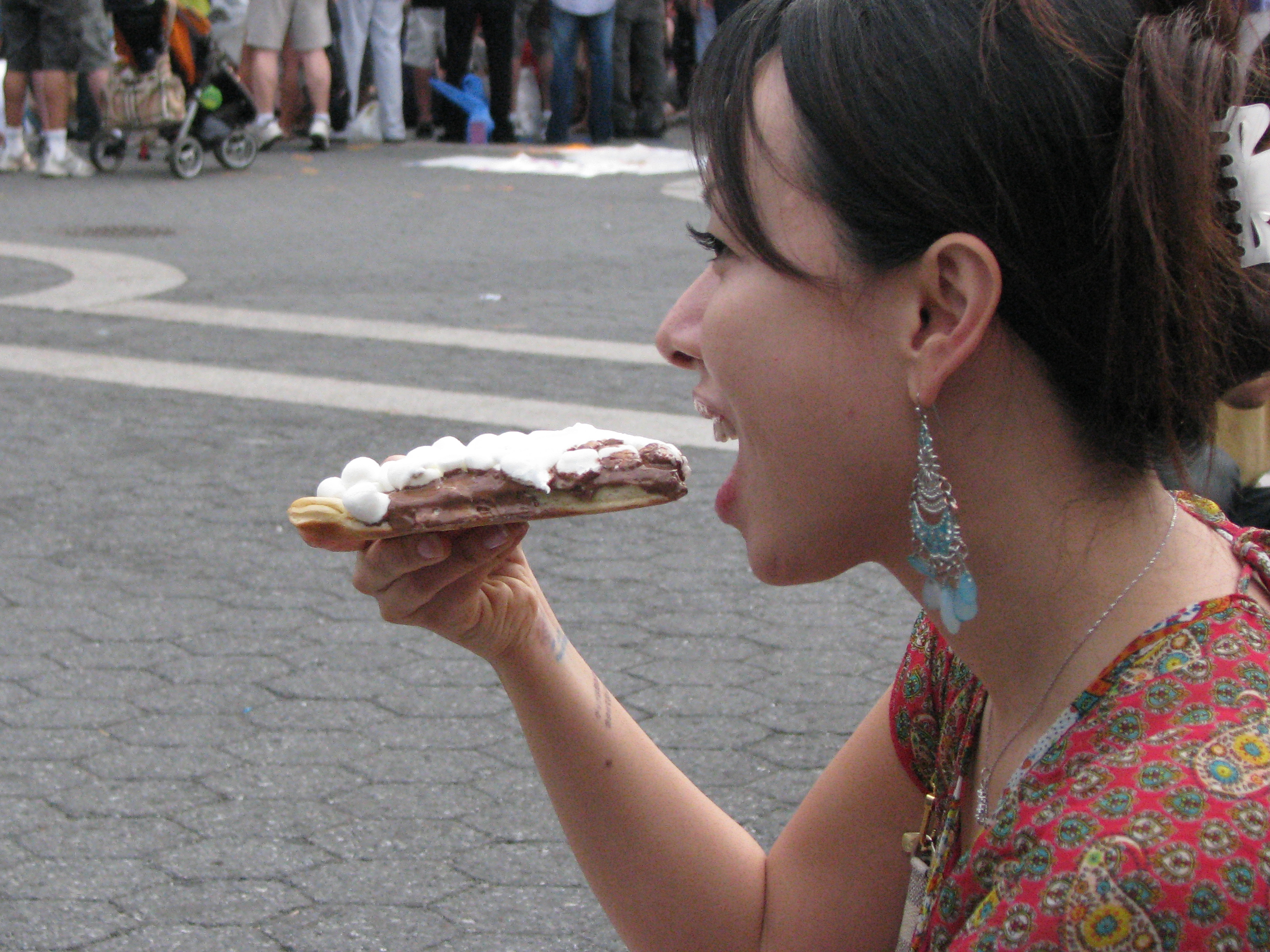 Woman eating chocolate pizza from Max Brenner's (weird teeth)