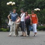 Tourist family pose for picture