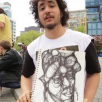 artist holding up his drawing