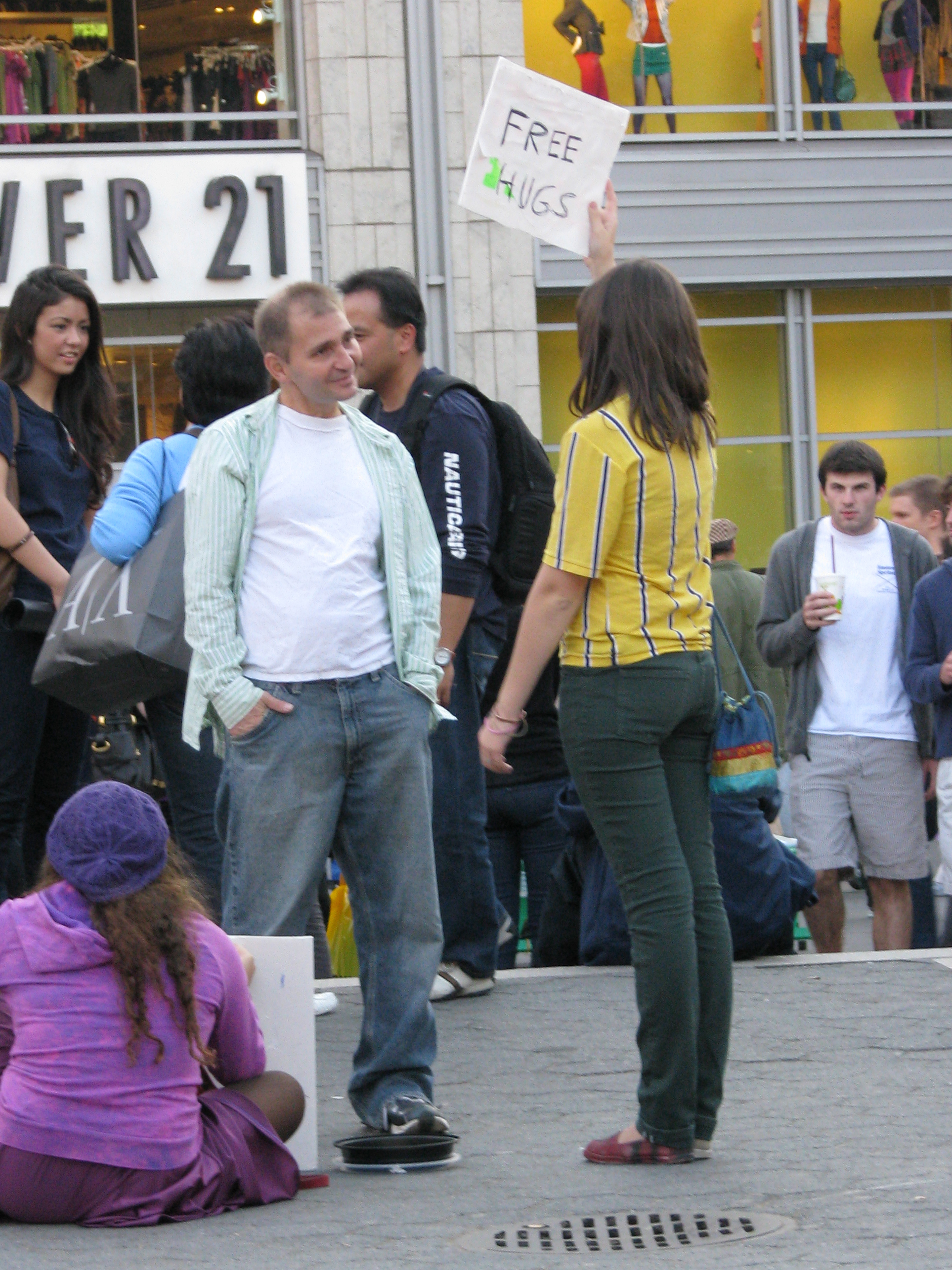 free hugs girl talking to man