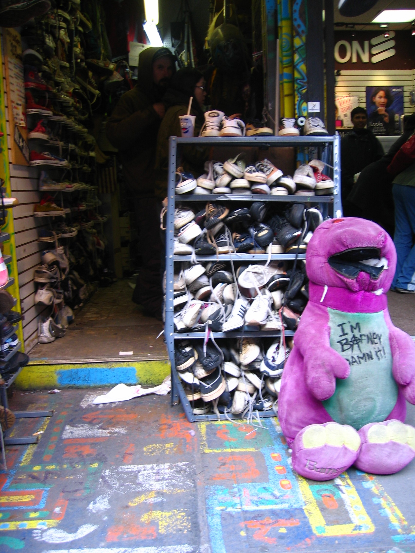 Barney stuffed toy outside of Boris's Shoe Repair