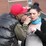 Junky examines girlfriends eye