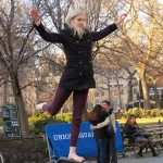 Blonde dancer girl balancing on railing