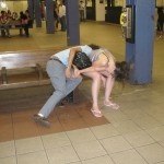 Couple passed out on subway bench