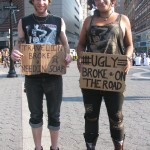 homeless kids spanging signs