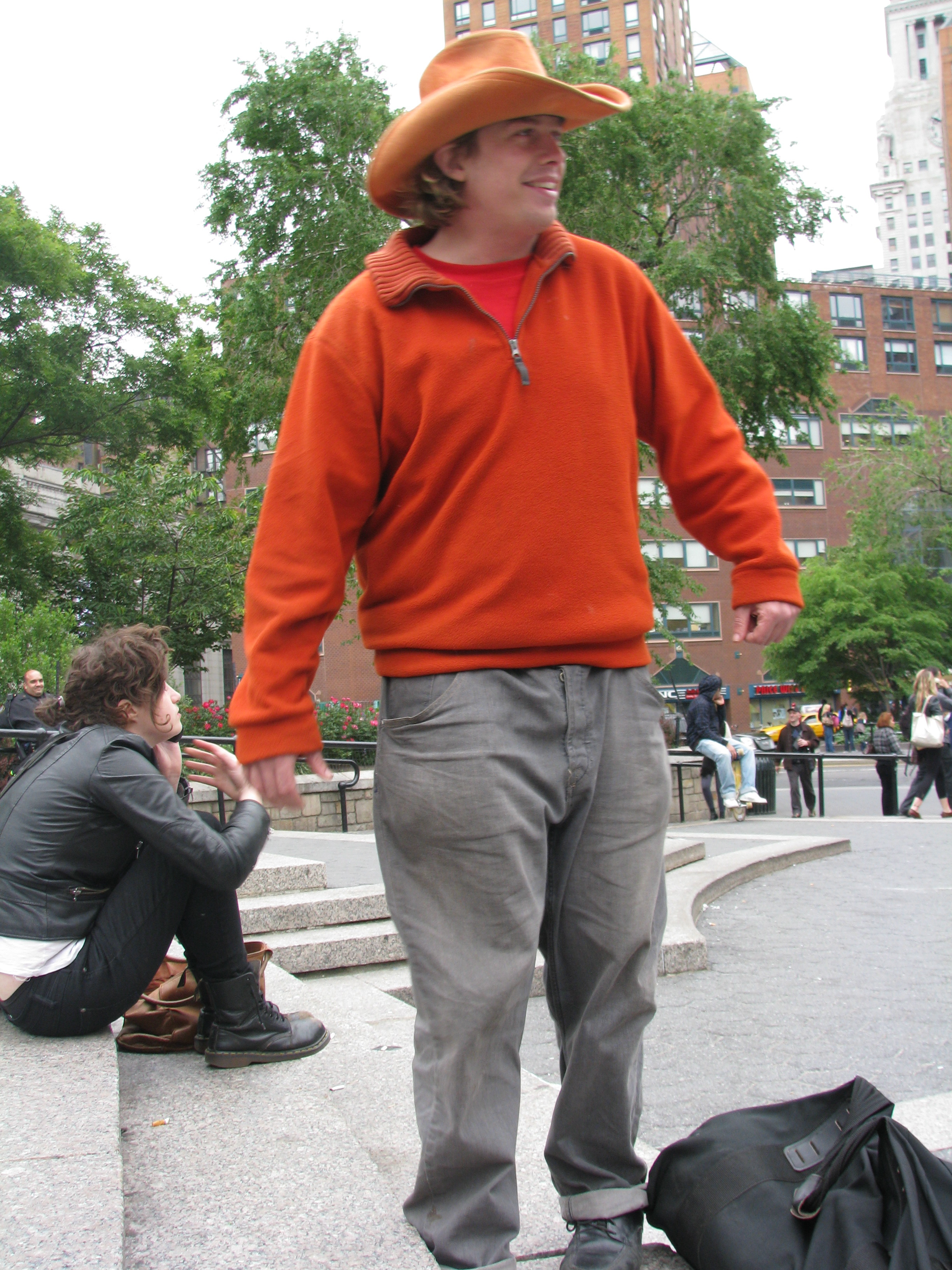 guy wearing orange hat & coat