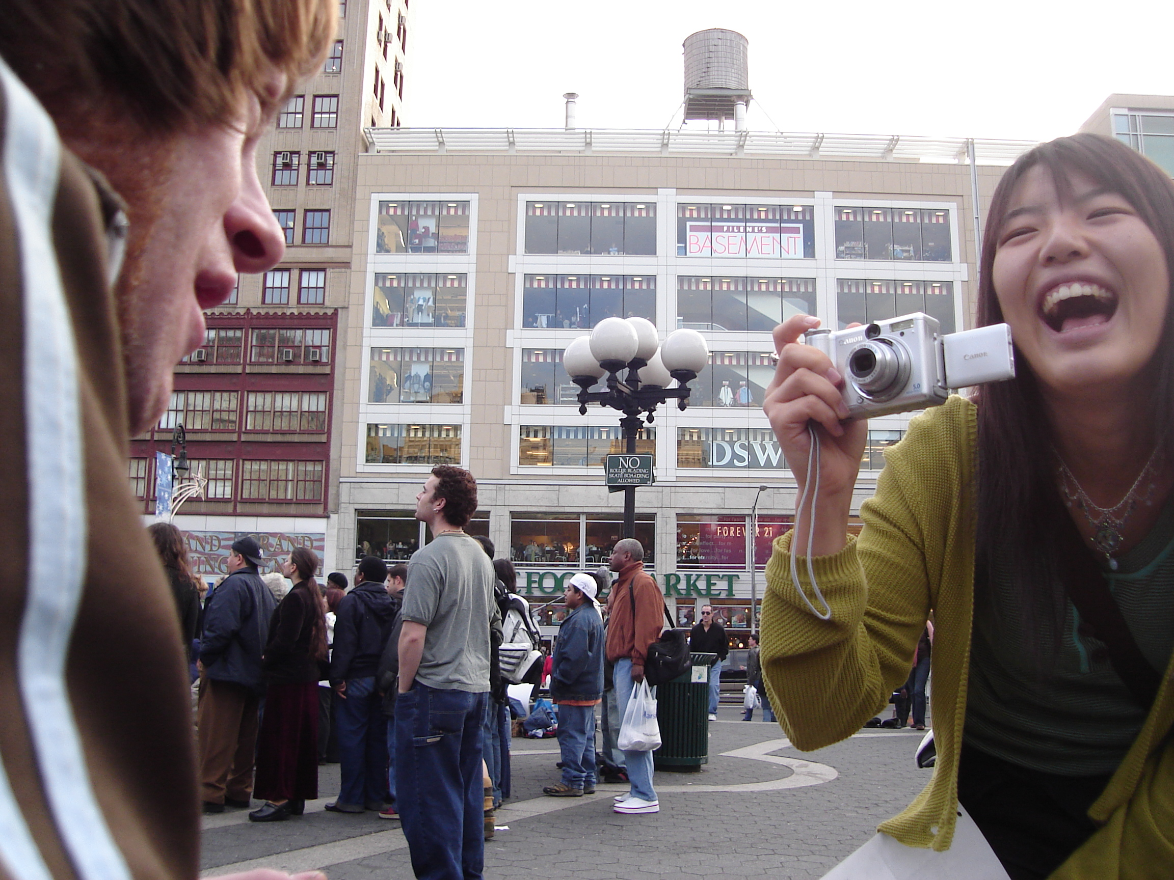 Woman laughing at Shaggy while taking his picture