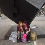 Asian Mall Punks sitting under The Cube at Astor Place