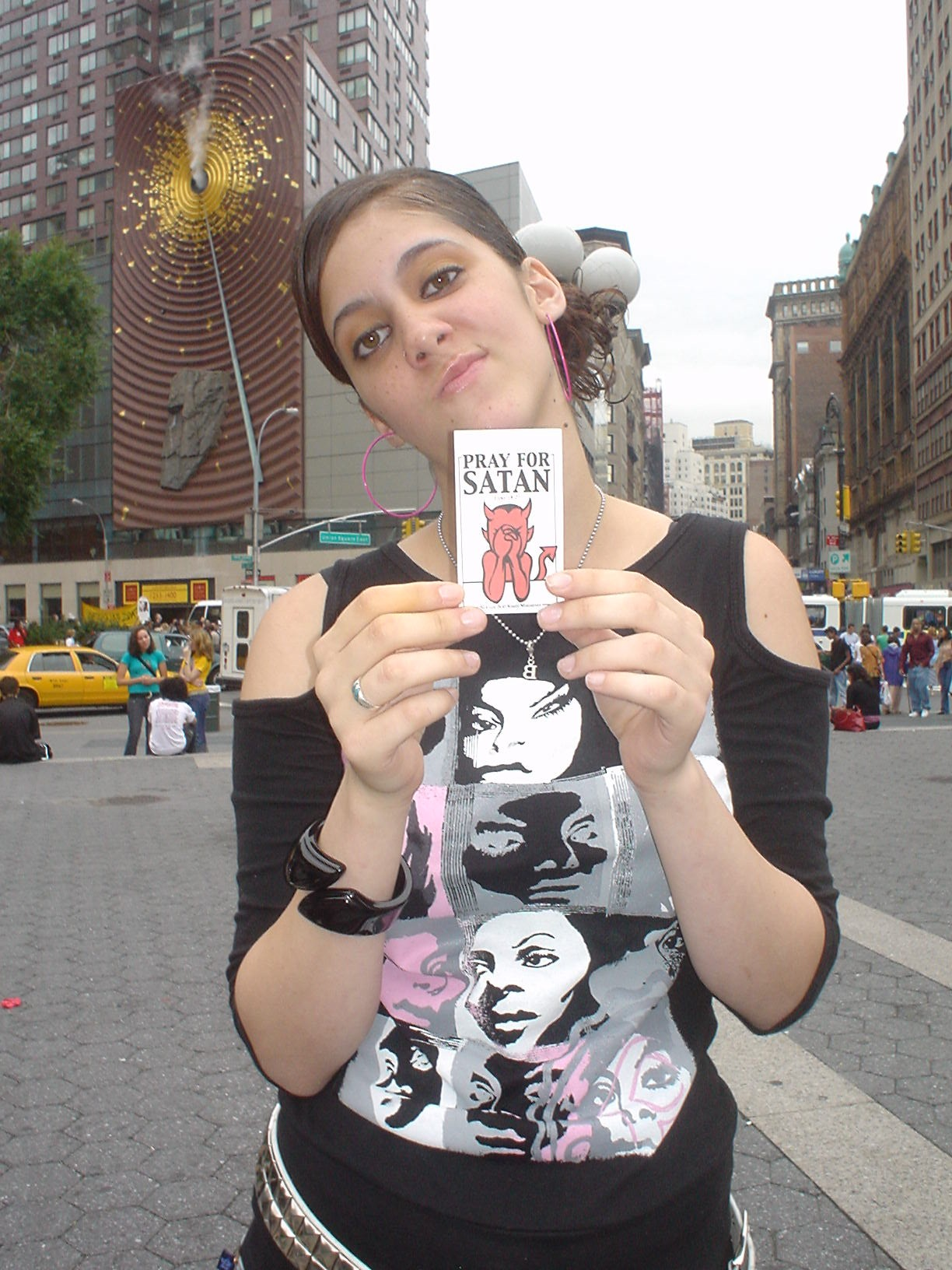 hood rat holding one of my PRAY FOR SATAN flyers