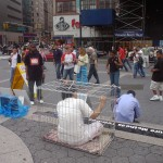Woman in cage for demonstration against torture in Falun Gong