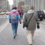 Woman in ugly coat with target on back