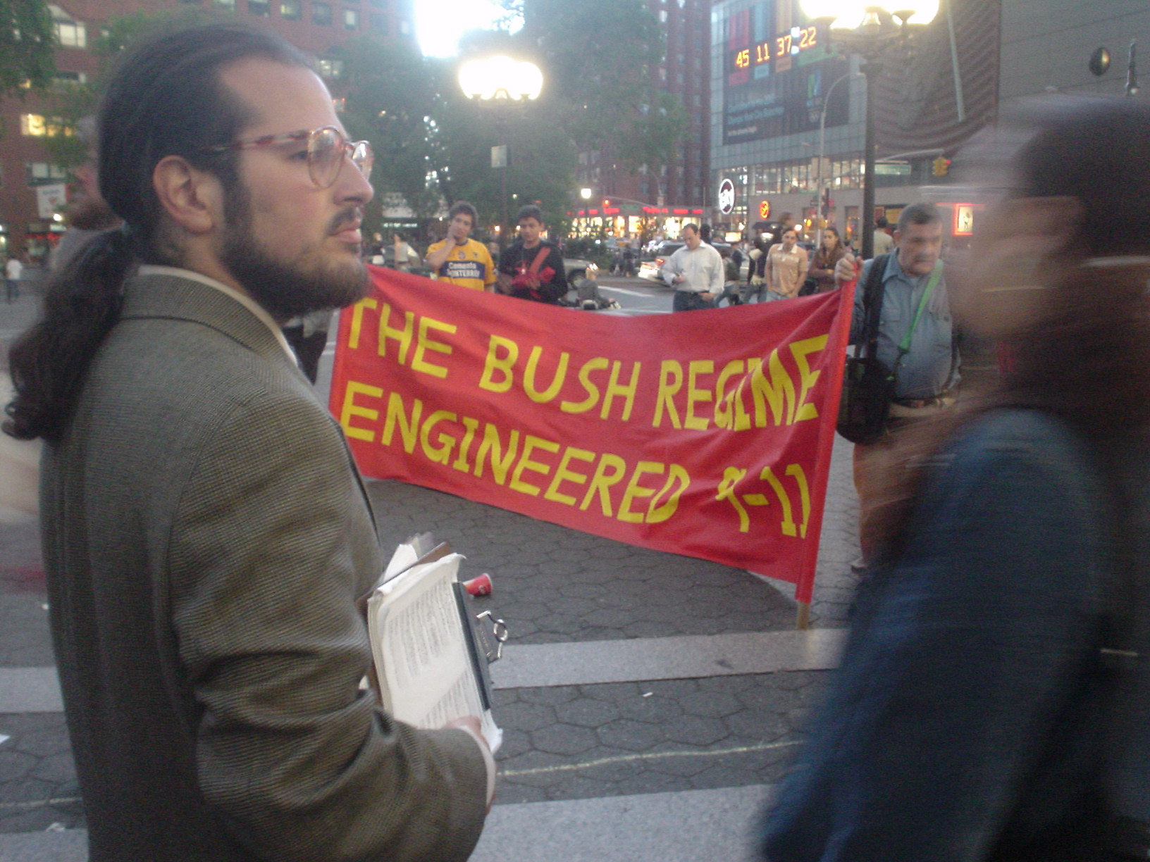 Jason Blank with BOSH REGIME ENGINEERED 9-11 banner