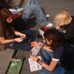 Girls cutting out flyers