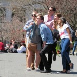 Group photo of tourists with selfie stick