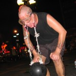 Roc Rockit with bowling ball suspended from earlobes