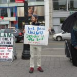 Gay guy protesting Islamic demonstrator