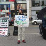 Gay guy protesting Islamic demonstrator
