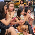 Girls drinking Starbucks on their Smartphones