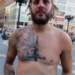 crusty punk with upside down crucifix tattoo