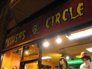Medusa's Circle storefront sign