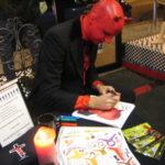 Normal Bob signing 8X10s at Medusa's Circle, Chicago