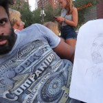 black artist with drawing of photographer